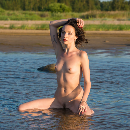 bare breasts: Beautiful naked woman an the beach against the sea
