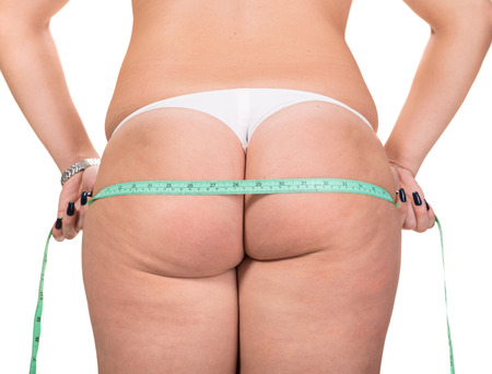 Woman making measure of her hips photo