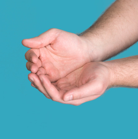 cupped hands: Hands cupped together on a blue background