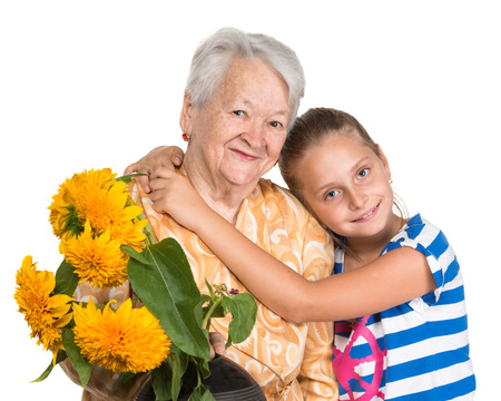 Grandmother and granddaughter on a white background