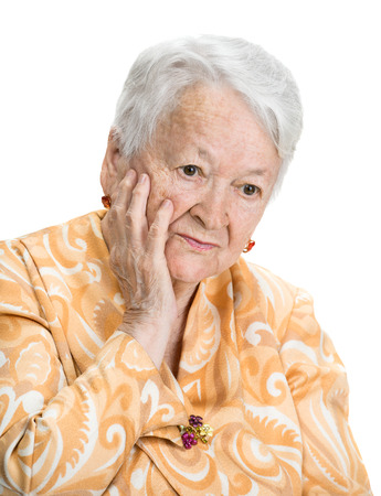 Portrait of thoughtful  old woman on a white background photo