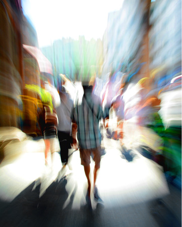 People going along the street in zoom effect Stock Photo