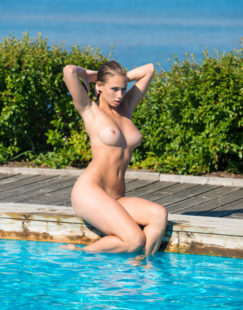 beautiful nude women: Beautiful young naked woman enjoying summertime in swimming pool