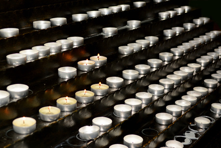 A lot of small candles in the church photo