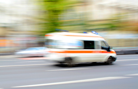 Ambulance in motion driving down the road. Intentional motion blur