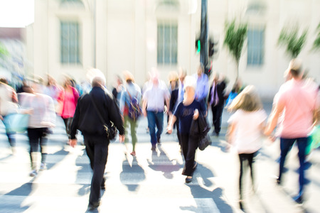 Busy city street people on zebra crossing. Intentional motion blur Stock Photo