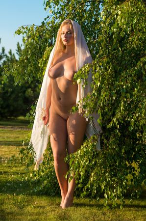 bare breasts: Beautiful young nude woman posing outdoor. Enjoy summer time