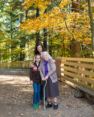 A multi generation portrait of a happy grandmother with her daughter and granddaughter outdoor photo