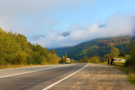 Autumn scenic view of  mountains and road in Ukraine photo