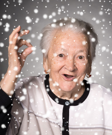 Old woman showing ok sign. Christmas and holidays concept photo