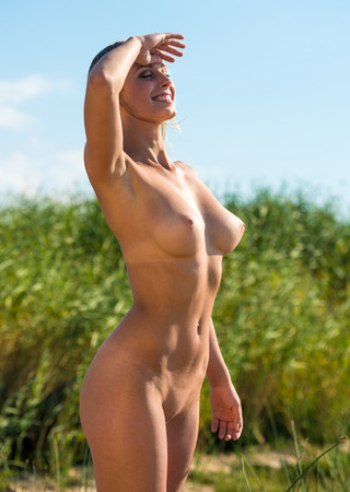 nude pose: Beautiful young nude woman posing on nature background
