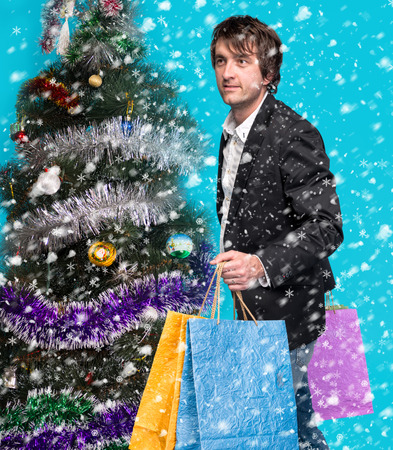 Handsome man holding shopping bags. Christmas and holidays concept photo