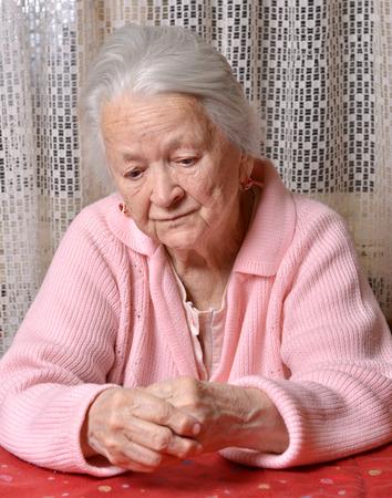 saddened: Portrait of old sad woman Stock Photo