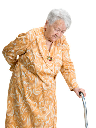 low back: Old woman suffering from low back pain on a white background Stock Photo