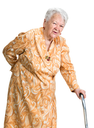 Old woman suffering from low back pain on a white background photo