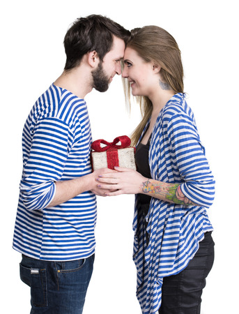 Smiling woman and man with gift box on a white background photo