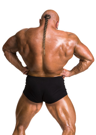 dorsi: Athlete bodybuilder demonstrating muscles of the back and arms on a white background
