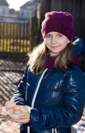 barn girls: Pretty girl holding fresh organic eggs Stock Photo