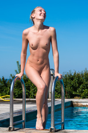 wet breast: Beautiful young naked woman enjoying summertime in swimming pool