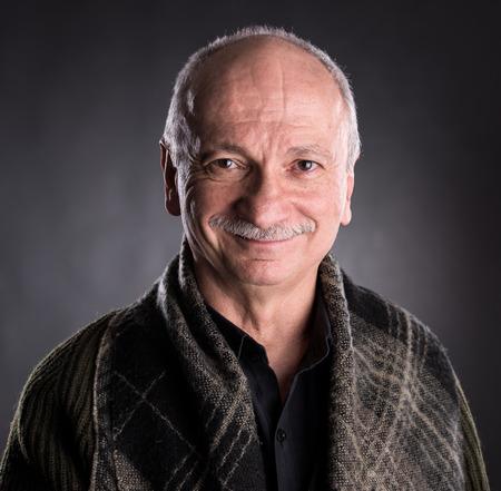 Smiling elderly man on a dark background 免版税图像 - 37957254