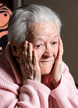 only one senior: Portrait of surprised old woman at home