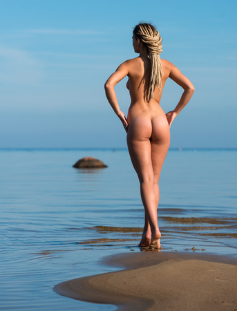 beach breast: Young beautiful nude woman posing on the beach