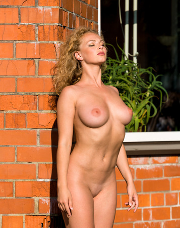 bare breast: Beautiful young nude woman enjoying summertime
