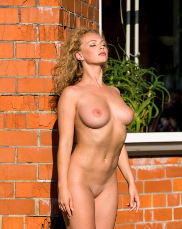 bare breast: Beautiful young nude woman enjoying summertime