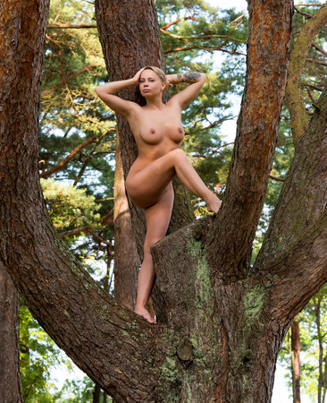 nudity young: Beautiful young nude woman posing outdoor Stock Photo
