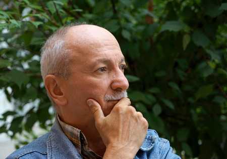 unhappy people: Portrait of thoughtful senior man outdoors