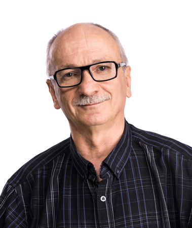 only adult: Portrait of a senior man with glasses on white background