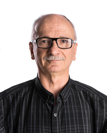 Portrait of a senior man with glasses on white background