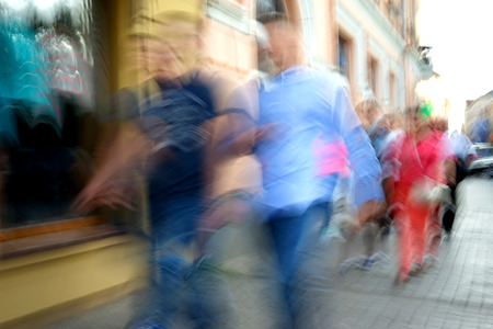 city people: Busy city people going along the street. Intentional motion blur
