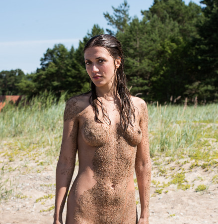 nudity young: Beautiful young naked woman enjoying summertime on the beach Stock Photo
