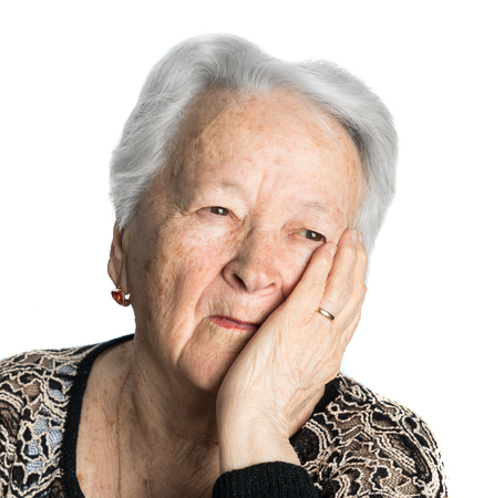 Old woman suffering from headache or toothache on white background