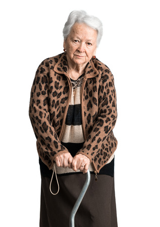 Old woman standing with a cane on a white background