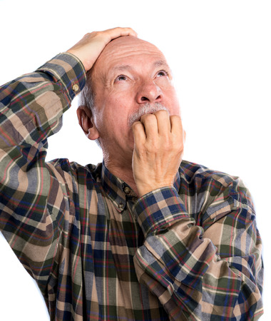 Shocked senior man on a light grey background