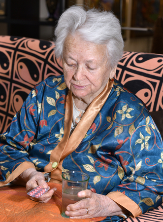 medicalcare: Old woman going to take the medicine at home