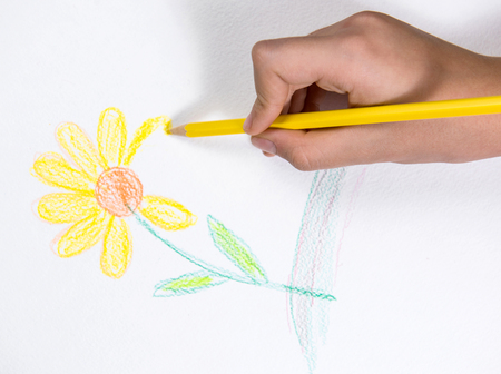 young schoolchild: Girl drawing yellow flower Stock Photo