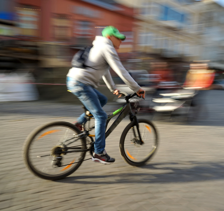 roadway: Cyclist on the city roadway in motion blur Stock Photo