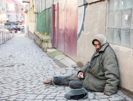 men face: Homeless man on the street of the city