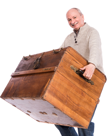 carries: Senior man carries a heavy box on a white background Stock Photo