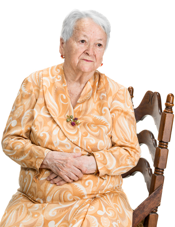 beautiful sad: Portrait of pensive old woman on white background