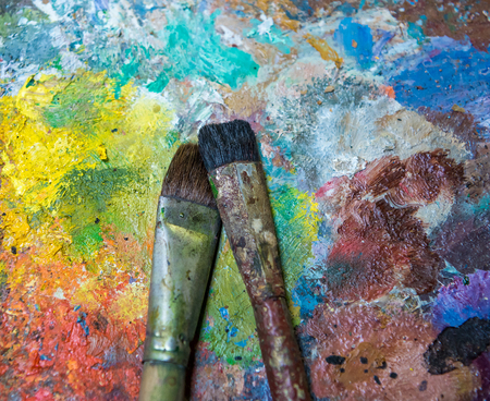paintbrushes: Artistic paintbrushes  on an old wooden palette