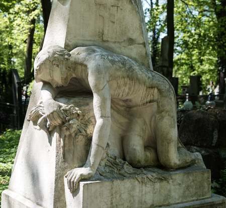 angel alone: Old statue on grave in the Lychakivskyj cemetery of Lviv, Ukraine