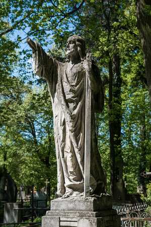 angel alone: Old statue on grave in the Lychakivskyj cemetery of Lviv, Ukraine.
