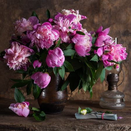 pack of dollars: Beautiful bouquet of pink peonies and  pack of dollars on a soft multicolored  background