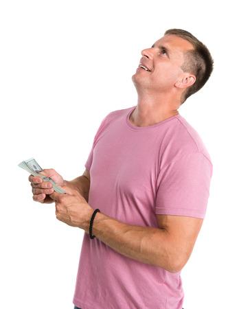 contaduria: Hombre feliz que sostiene paquete de dinero en un fondo blanco