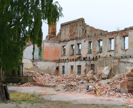 Demolishing of an old apartment building Stock Photo
