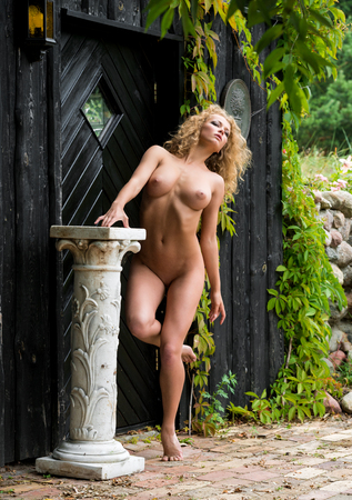 nude blonde girl: Beautiful nude woman posing near the old country house